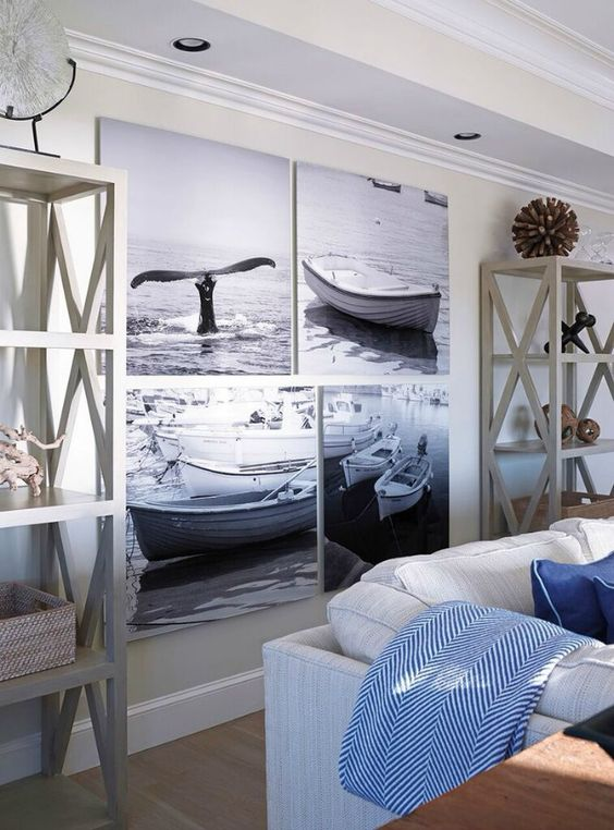 salotto-ispirazione-casa-al-mare-tavolino-quadri-barche